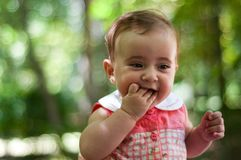Six months old baby girl having fun outdoors. Royalty Free Stock Photography