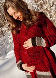 Six months pregnant woman in the winter Stock Image