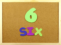 Six mots sur un corkboard Photos stock