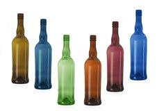 Six multi-coloured bottles Stock Photography