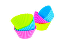 Six multicolor silicone muffin pans Stock Images