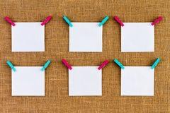 Six neatly aligned blank white notepads Royalty Free Stock Image