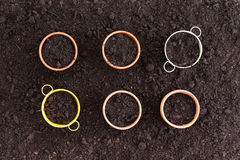 Six neatly arranged planters filled with soil Stock Photos