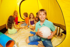 Six nice kids are sitting in a tent Stock Photos