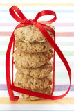 Six oatmeal cookies tied with a red ribbon Stock Images
