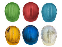 Six old colorful construction helmets Stock Photography