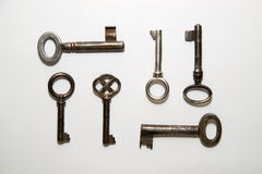 Six old  keys to the safe on a white background Royalty Free Stock Images