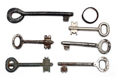 Six old rusty keys and keyring Royalty Free Stock Images