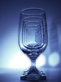 Six of One. Glasses in a line lit by high intensity L.E.D's Stock Photos