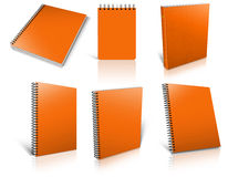 Six orange spiral blank notepad on white. Stock Images