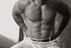 Six pack. Sepia male with a chiseled stomach Stock Photo