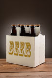 Six Pack Beer on Wood Table Stock Image