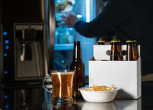Six pack of brown beer bottles on kitchen counter Royalty Free Stock Image