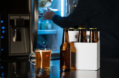 Six pack of brown beer bottles on kitchen counter Stock Images
