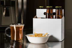 Six pack of brown beer bottles on kitchen counter Stock Image