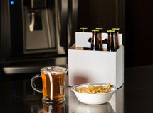 Six pack of brown beer bottles on kitchen counter Royalty Free Stock Photo
