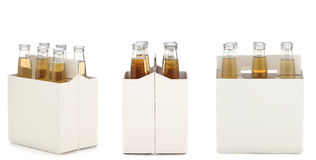 Six Pack of Clear Beer Bottles. Three views of a Six Pack of Clear Beer Bottles isolated over white with reflection Royalty Free Stock Photos