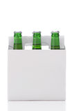 Six Pack of Green Beer Bottles. In Cardboard Carrier isolated on white with reflection vertical format Royalty Free Stock Images