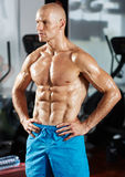 Six packs athlete in a gym Stock Images