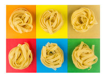 Six pasta on multicolored paper Stock Images