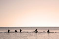Six people in water. Silhouette of six people in water Stock Photo