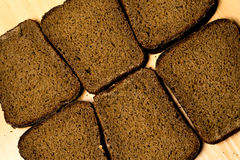 Six pieces of black bread stock image