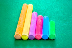 Six Pieces of Chalk in a Line Royalty Free Stock Photos