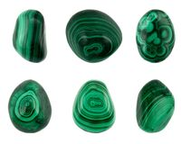 Six pieces good quality green malachites isolated on white background. Six different pieces good quality malachite stones isolated on white background. Polished stock photos