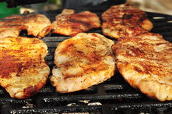 Six pieces of marinated chicken breast. On the grill Stock Image