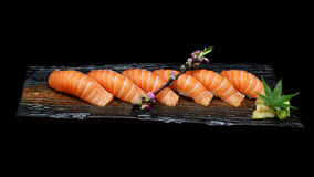 Six pieces of Salmon sushi set on wooden ceramic plate with. Japanese tradition food style. Royalty Free Stock Photography