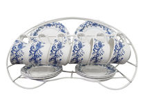 Six Place Set of Cups Plates and Saucers on a Rack Royalty Free Stock Images