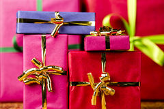 Six Plain Gifts Wrapped for Any Occasion. Presents packed in plain colors with bows. Tightly cropped, flattened space. Background for any gift exchange Stock Photo