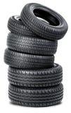 Six pneus sur le fond blanc Photo libre de droits