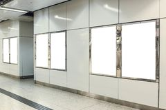 Six portrait orientation blank mock up advertisement light boxes at a metro station.  Royalty Free Stock Images