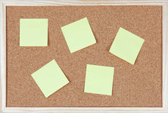 Six post-it notes sticked on corkboard Royalty Free Stock Image