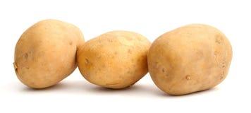 Six potatoes Stock Photography