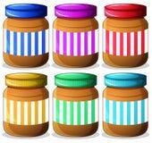 Six pots de beurres d'arachide Images stock
