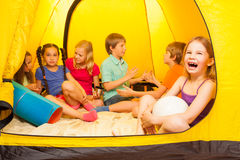 Six pretty kids in a tent royalty free stock images