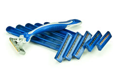 Six razors. Six blue razor on an isolated white background Royalty Free Stock Photography