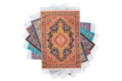 Six rectangular carpets lie on spiral. Six rectangular varicoloured carpets lie on spiral on white background Stock Images