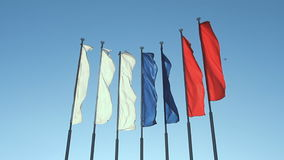 Six red, blue and white flags. Fluttering on the wind stock footage
