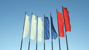 Six red, blue and white flags. Fluttering on the wind stock video