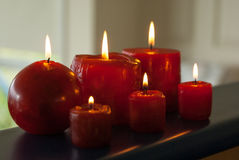 Six red candles burning. In low light Royalty Free Stock Photos