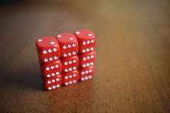 Six red dice on a table Royalty Free Stock Image