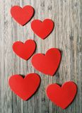 Six Red Hearts on Wood Stock Images