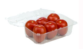 Six Red Tomatoes In Plastic Retail Supermarket Packaging. Isolated on white background royalty free stock image