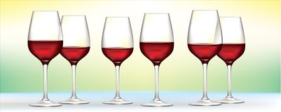 Six  red wine glasses. Six red wine glasses on soft green to yellow background Stock Image