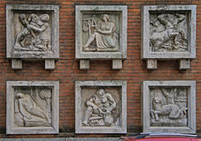 Six relief picture on the wall in Milan Stock Image