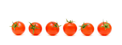 Six ripe tomatoes on a white background Royalty Free Stock Photography