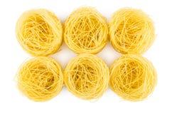 Six rolls of pasta capellini isolated on white Stock Photo
